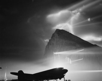 Douglas DC-3 at Gibraltar, Searchlights in background, WWII Era