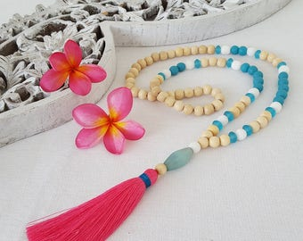 Pink tassel necklace with turquoise , white and wooden beads with raspberry pink tassel