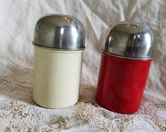 Two aluminum lidded canisters