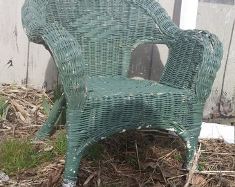 vintage childs wicker chair with origanial green patina paint
