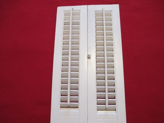Two Hinged White Wooden Louvered Interior Window Shutters That