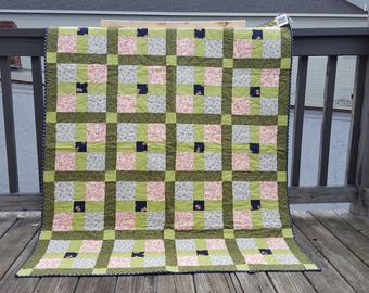 green pink and blue throw
