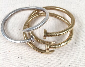 Nail bangle in silver or bronze