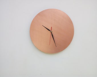 Modern wall clock in real finely crafted copper, maintains the color you see in the picture in time.