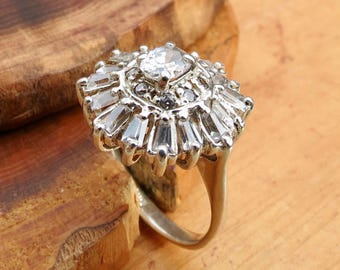 A vintage silver white stone cluster ring