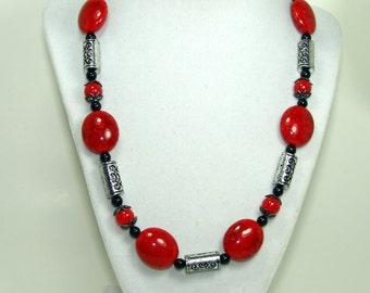 Red necklace. Red and black necklace. Red and black beaded necklace. Red and black jewelry. Red and black beaded jewelry.