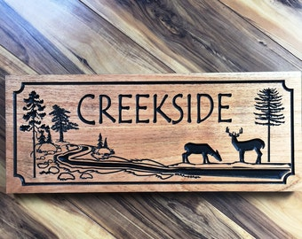 Cabin Sign Wood Carved Plaque With Rolling Creek Deer Pine Trees Camp Name Lodge Sign with Stream Buck and Doe Wildlife Wooded Scenery