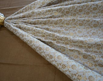 Cream Art silk jacquard fabric with gold floral pattern