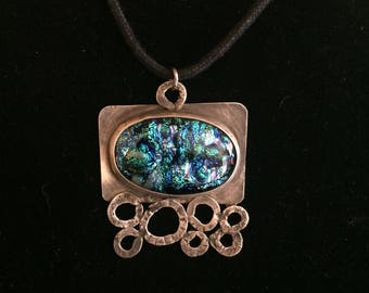 Sterling silver with bezeled blue dichroic glass pendant