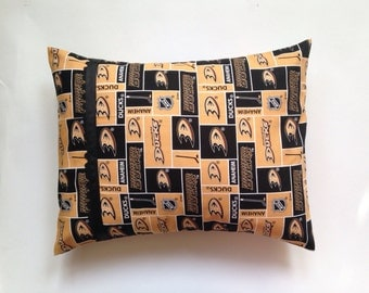 Anaheim Ducks Pillow with black grosgrain ribbon and black ric rac.