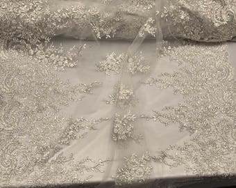 Ivory metallic french flower design embroider and beaded on a mesh-wedding-bridal-prom-nightgown-sold by the yard.