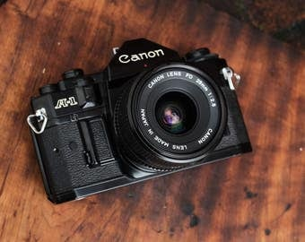 Canon A-1 Black - Vintage SLR Camera -  Working Condition - with Canon FD 28mm 2.8 Lens