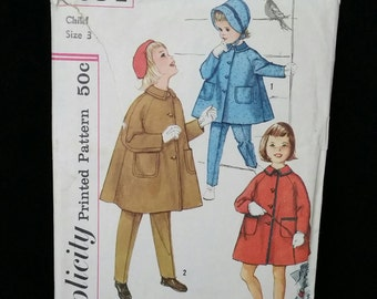Simplicity Pattern 1960s Child Coat, Taper Pants and Hat.