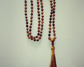 Mala with Tiger eye stones. To order.