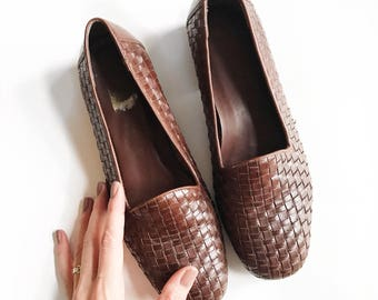 Dark brown woven leather flat loafers. Size 10.