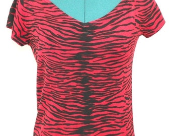 Red v-neck top with cap sleeves and animal print design. By Jacke. Unique top, fun top, summer top, light top