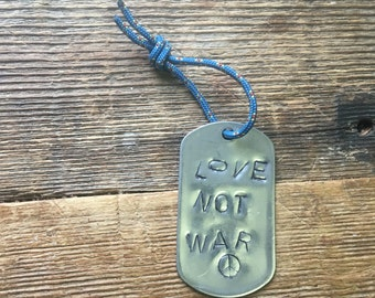 Love not war ' dogtag with peace sign !