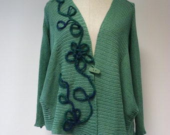 The hot price. Exceptional pea-green coloured cardigan with felted decoration, L size. Made of cotton.