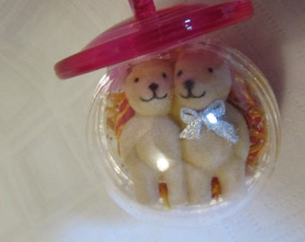 Ball hanging pacifier-shaped with couple of bear plush