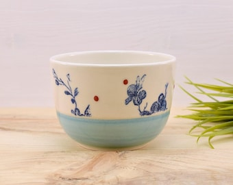 Bowl to the turquoise - blue flowers and red dots