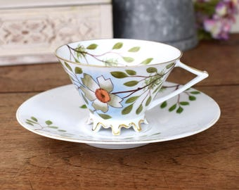 Beautiful vintage tea cup and saucer, unusual shaped cup