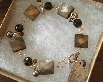 Mother of pearl and smokey quartz gold bracelet /  finished with vintage heart charm