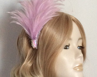 MAUVE FEATHER FASCINATOR, Hackle and tipped coque feathers, sequins,mounted on a comb