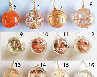 Unique handmade dome/orb design resin necklaces.Only one available of each,choose which one you would like from the dropdown menu.