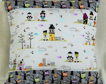 Decorative pillow case white and gray with comic scenes of monsters and witches and many owls on bare trees