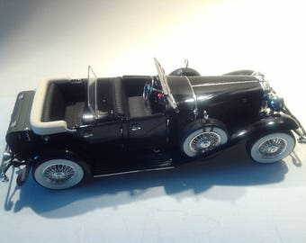 "Model car, ""1934 Duesenberg""."
