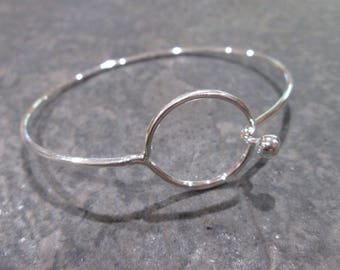 Buckle Loop Bangles Oval shaped with round loop detail and shiny silver band