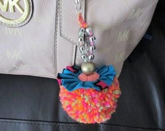 Afrocentric Ankara fabric pom pom bag charm. Crazy colours.