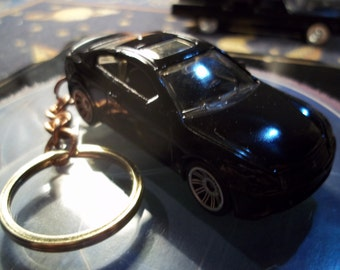 custom made keychain,2010 infiniti g37 coupe,flat black w/black tires on silver mags/repaint mint