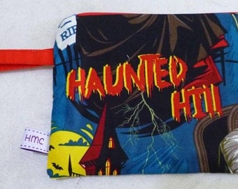 Small zippered bag.  Haunted Hill  print.   18cm x 13cm.   Fully lined and washable.