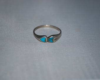 Sterling silver ring size 7 with turquoise inlay.