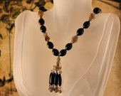 1940s Costume Jewelry: Necklaces, Earrings, Brooch, Bracelets Vintage Mid Century Black  Gold Tassle Necklace Sgined Crown Trifari $40.00 AT vintagedancer.com