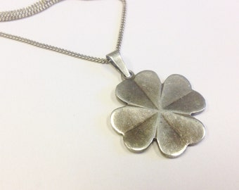 Sterling silver, lucky, four-leaved clover pendant on chain.