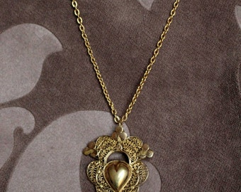 filigain openwork pendant with cut-out hearts