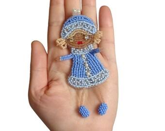 Dressed in winter girl brooch | Beaded art doll brooch | Light blue jewelry for little girl | Mini doll brooch | Scarf pin brooch for baby
