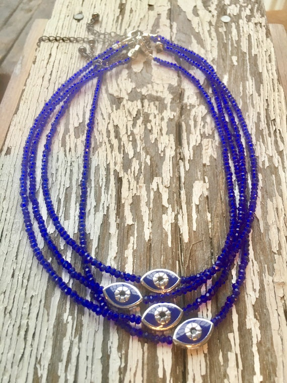 Evil Eye Charm & Blue Crystal Necklace