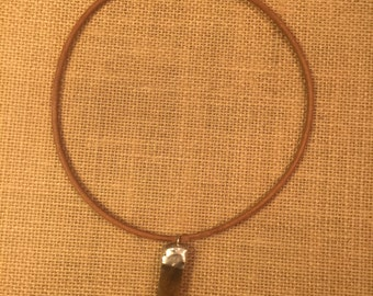 Leather necklace with a soldered stone chunk