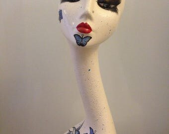 Swan neck mannequin head blue rose, butterfly and birds tattoo theme. Hat wig display