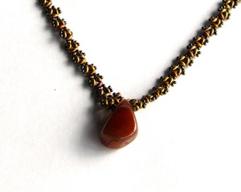 Beaded necklace with a Agate pendant