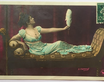 Woman in Victorian dress lying down, admiring herself in plush hand mirror * Vanity * Antique French postcard 1909