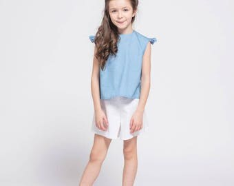 Child blue blouse with Ruffles sleeveless
