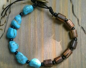 Bracelet Turquoise. Wooden beads. Leather band