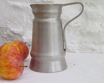 A vintage French pewter jug.