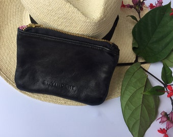 Cute black leather coin purse with pink lining