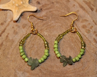 Beaded hoop earrings with green glass beads