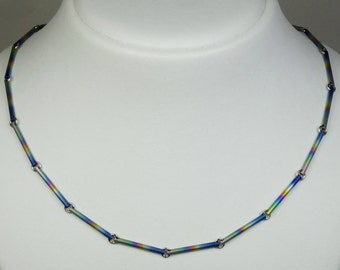 Anodized rainbow colours titanium and steel rings necklace.